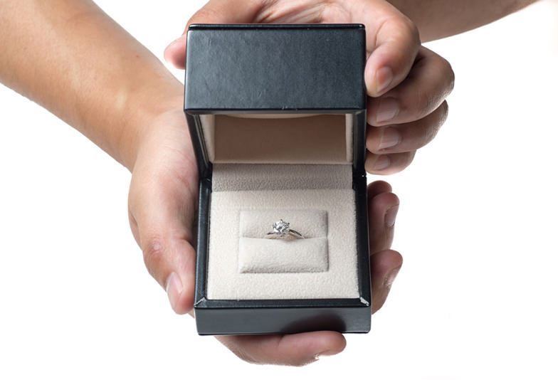 holding diamond ring